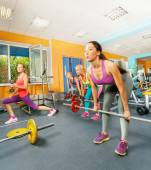 Girls exercising with barbell — Foto de Stock