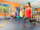 Four women excursing in fitness club — Stock Photo