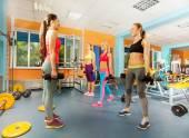Young women exercising in gym — Foto de Stock