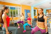 Girls doing exercises in gym — Foto de Stock