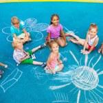 Children draw with chalk on playground — Stock Photo #52725363