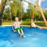 Swinging in park — Stock Photo #52725495