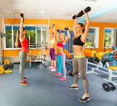 Fit young women in fitness club — Stock Photo