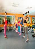 Instructor and three women exercising — Foto de Stock