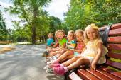 Boys and girls rest in park — Stock Photo
