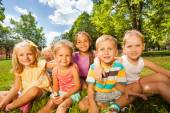 Boys and girls on lawn — Stock Photo