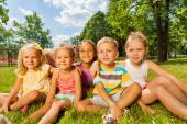 Kids on lawn in park — Stock Photo