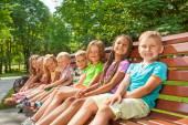 Children sit on bench — Stock Photo