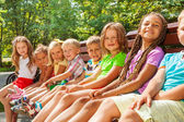 Little children sit on bench — Stock Photo