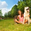 Nice teenage girl with her dogs — Stock Photo #52852573