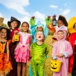 Happy excited kids in Halloween costumes — Stock Photo #52853329