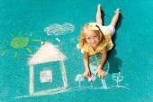 Blond girl and chalked drawing — Stock Photo