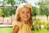 Smiling happy blond little girl — Stock Photo