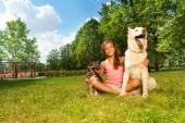 Nice teenage girl with her dogs — Stock Photo