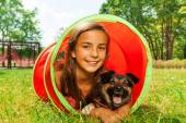 Girl with dog in playground tube — Stock Photo