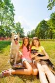 Happy teenage girls and nice dogs — Stock Photo