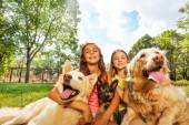 Girls and dogs — Stock Photo