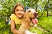 Teenage girl with her dog — Stock Photo