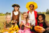 Multinational kids in Halloween costumes — Stockfoto