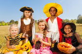 Multinational kids in Halloween costumes — Foto Stock