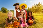 Multinational children in Halloween costumes — Stockfoto