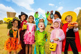Happy excited kids in Halloween costumes — Stok fotoğraf