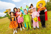 Children in different Halloween costumes — Stock Photo