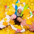 Kids play with autumn maple orange leaves — Stock Photo #60425859