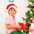 Boy in Santa hat with presents — Stock Photo #60425925
