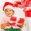 Boy in Santa hat with presents — Stock Photo #60426001