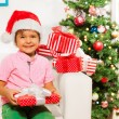 Boy in Santa hat with presents — Stock Photo #60426339