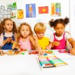 Boys and girls play with plasticine — Stock Photo #60426561