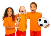 Soccer team with prize cup screaming — Stock Photo