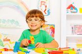 Smart boy in glasses with hammer — Stock Photo