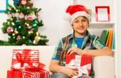 Happy boy with Christmas presents — Stock Photo