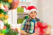 Boy with Christmas gifts — Stock Photo