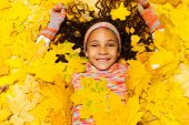 Girl covered with leaves — Stock Photo