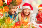 Boys and girl wit Christmas presents — Stock Photo