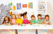 Boys and girls play with plasticine — Stockfoto