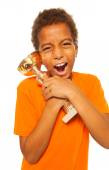 Boy holding winners cup prize — Stock Photo