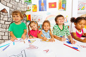 Kids drawing and filling letters — Stock Photo