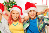 Boys and girl at Christmas party — Stock Photo