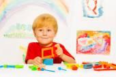 Little boy holding hacksaw — Stock Photo