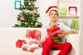 Happy boy with Christmas presents — Stock Photo