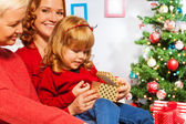 Family opening New year present — Stock Photo