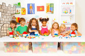 Happy kids playing with colorful blocks — Stock Photo
