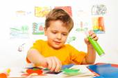 Boy crafting and holding glue — Stock Photo