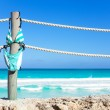 Stripped bikini hanging on ropes of pier — Stock Photo #60706821