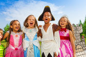 Kids in different costumes — Stock Photo