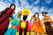 Kids in Halloween costumes — Stock Photo